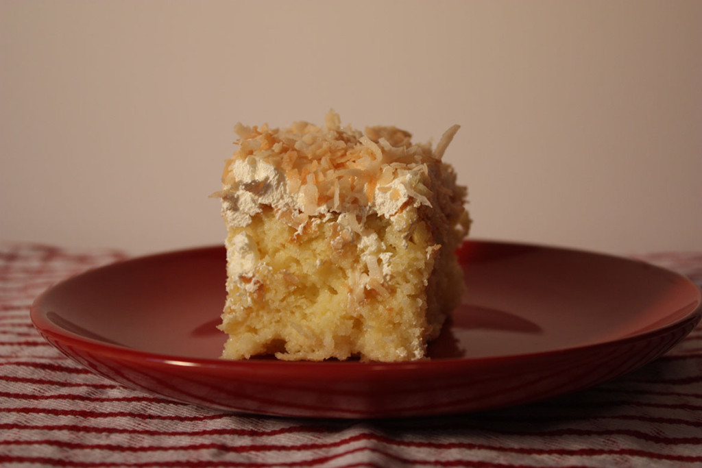 slice of the coconut cake on a red plate