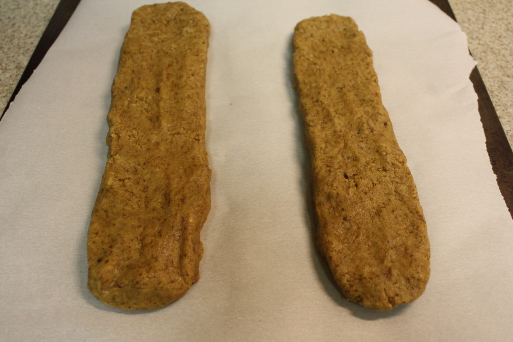 Espresso Biscotti dough formed on a parchment paper lined baking sheet