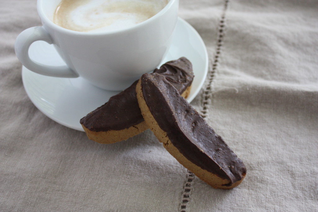two Espresso Biscotti leaned against a coffee cup and saucer