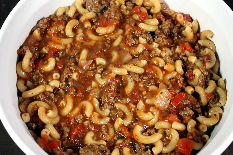 Cheesy Beefaroni ingredients in a white casserole
