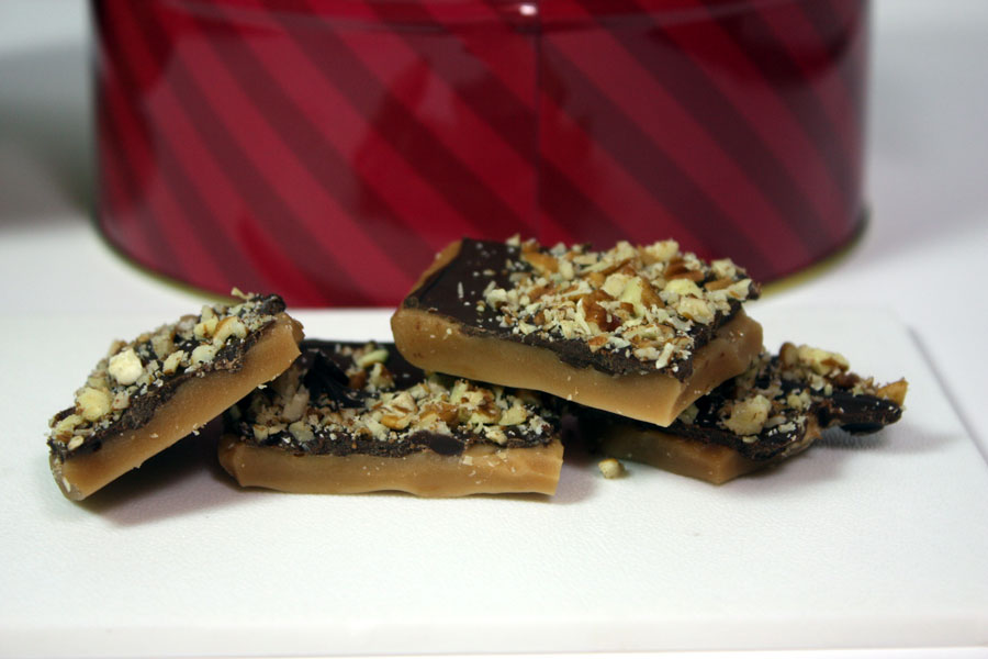 English Toffee pieces stacked on a white plate