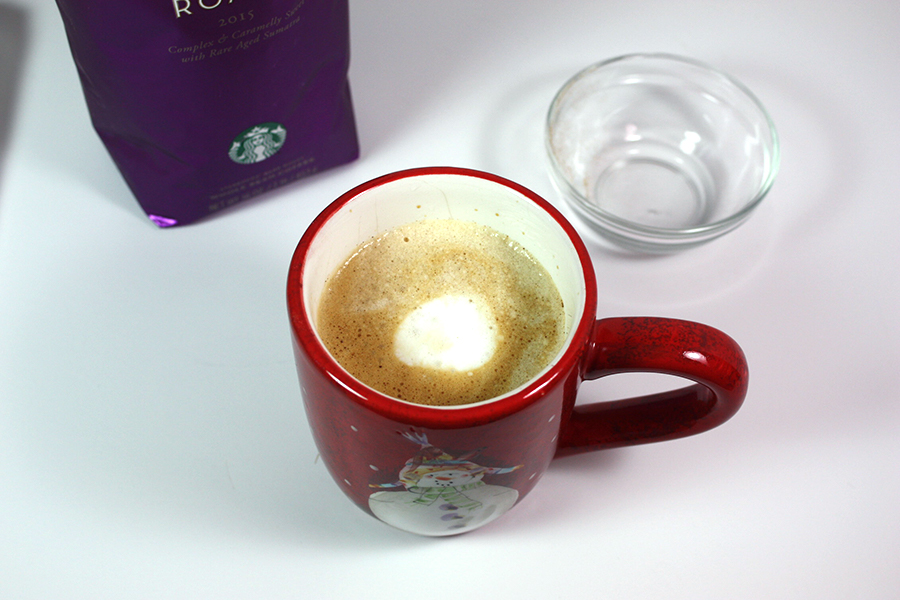 Holiday Spice Flat White in a red Christmas coffee mug