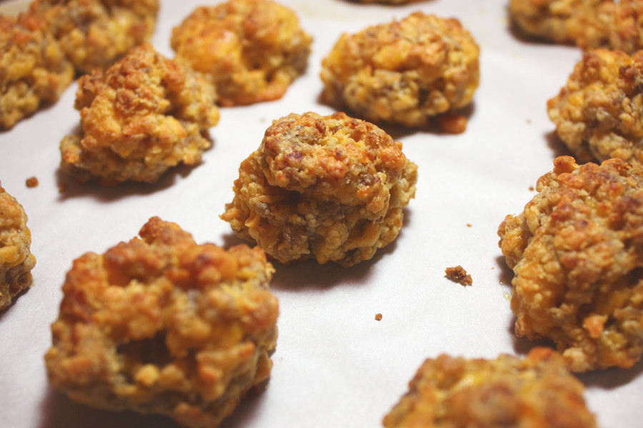 close up baked sausage balls on parchment paper