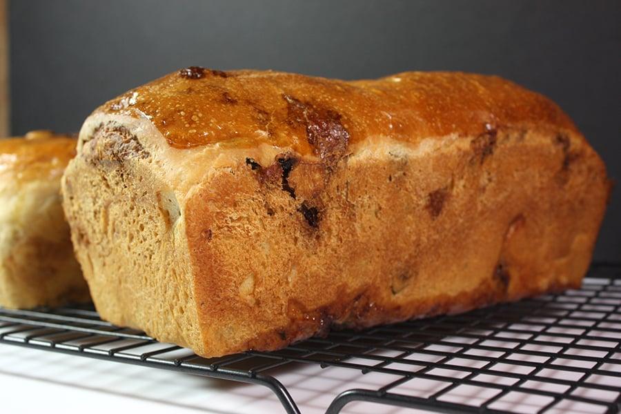 Cinnamon Raisin Bread loaves on a wire rack
