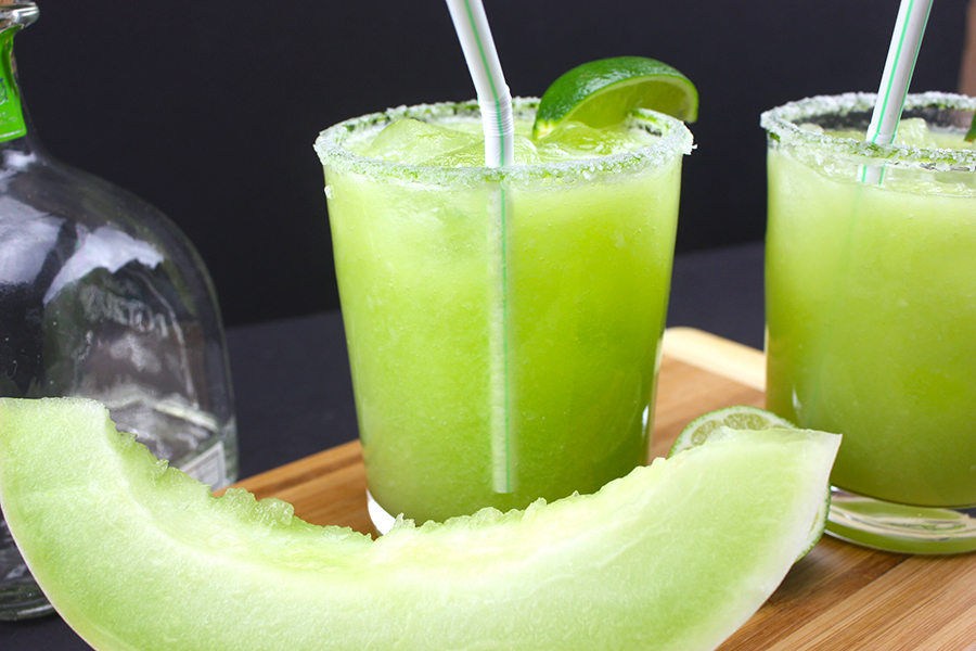 Honeydew Margaritas garnished with lime wedges