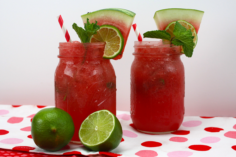 watermelon Mojito in two mason jars garnished with fresh mint watermelon wedges