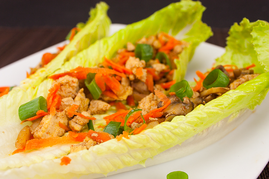 Vegetarian Lettuce Wraps on a white plate garnished with green onions