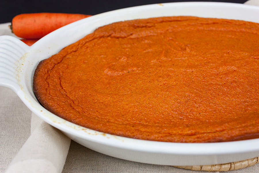 Carrot Souffle baked in an oval white baking dish