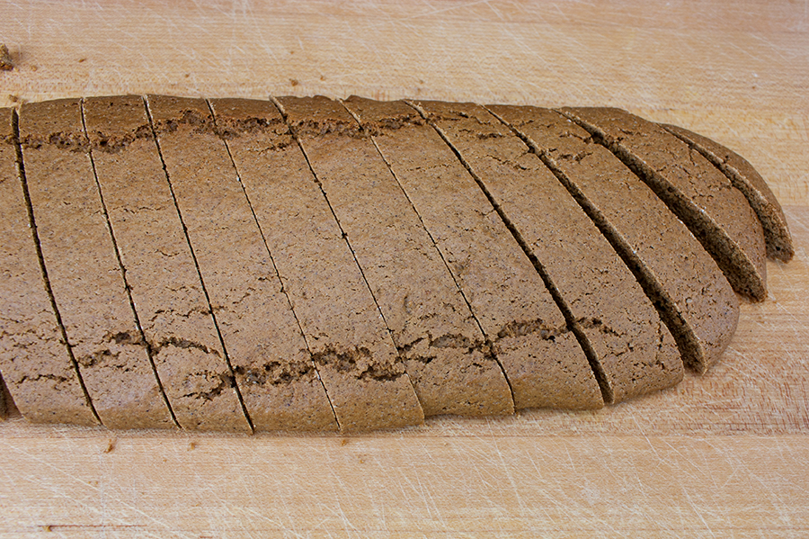 Gingerbread Biscotti sliced on a wooden cutting board