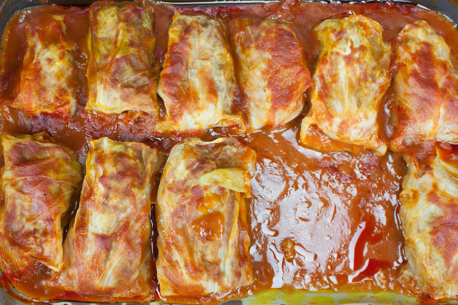 Easy Stuffed Cabbage Rolls - Tender leaves of cabbage stuffed and rolled with beef, garlic, onion and rice, simmered in a rich tomato sauce.