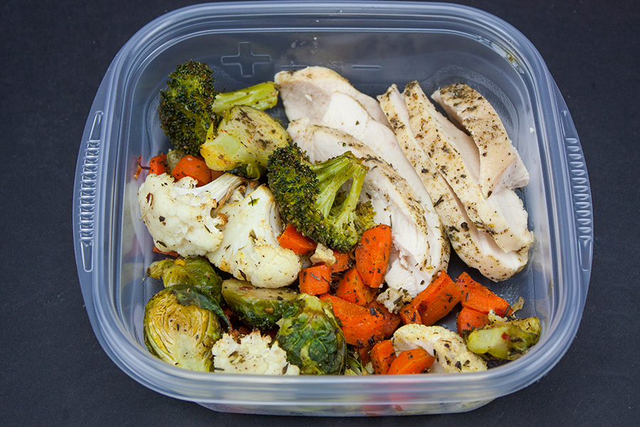 Sheet Pan Roasted Chicken and Vegetables portioned in a plastic container