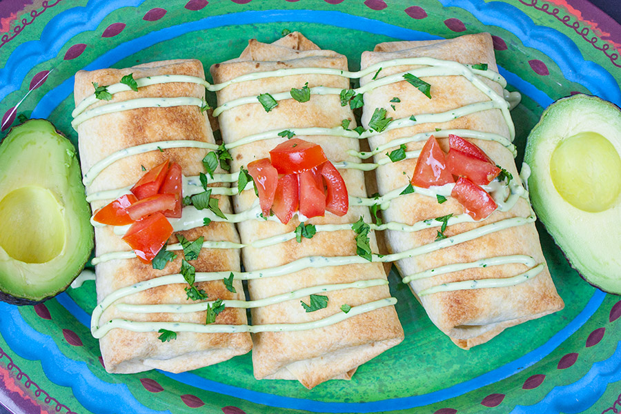Baked Chicken Chimichangas on a green platter