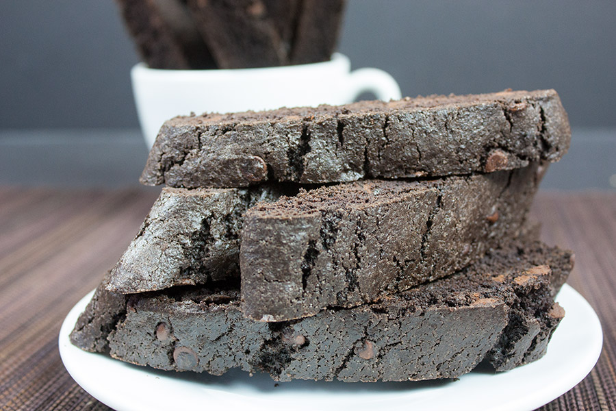 dark chocolate biscotti stacked on white plate