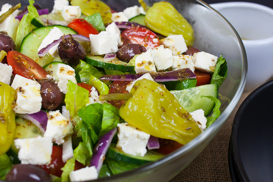 Greek salad in clear bowl