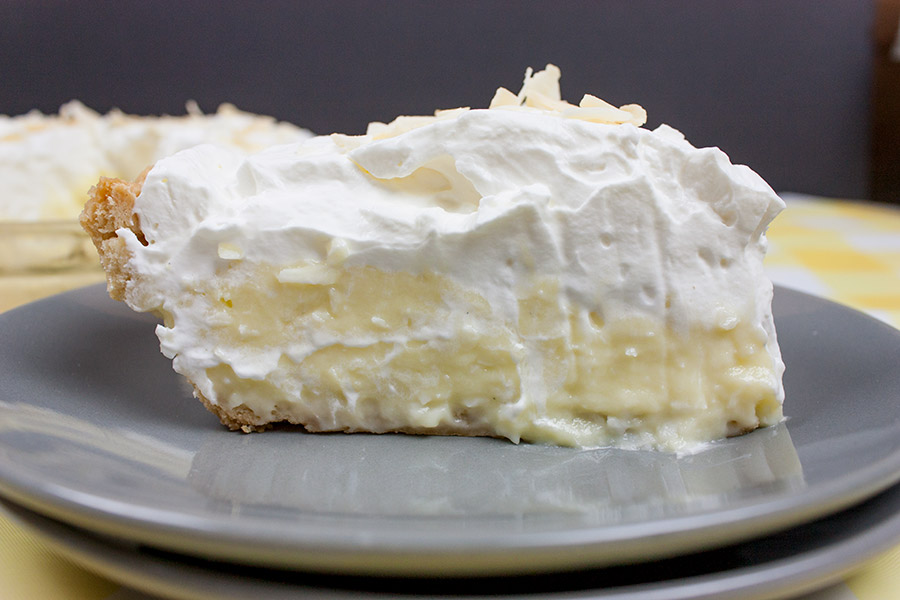 slice Coconut Cream Pie on gray plate