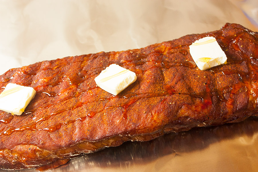 St Louis Style Ribs topped with butter and honey