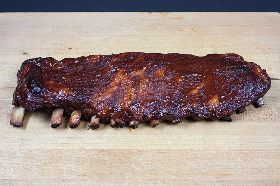 St Louis Style Ribs on a wooden cutting board