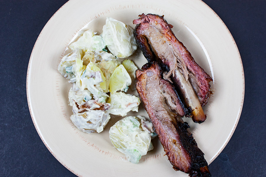 St Louis Style Ribs on a plate with potato salad