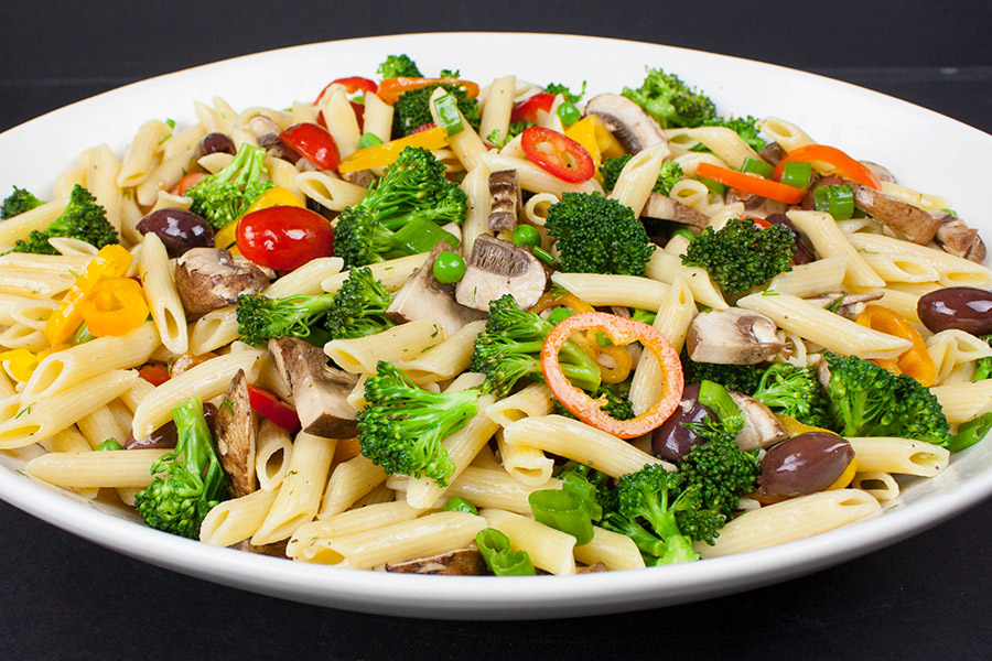 Lemon Veggie Pasta Salad in a large white serving bowl