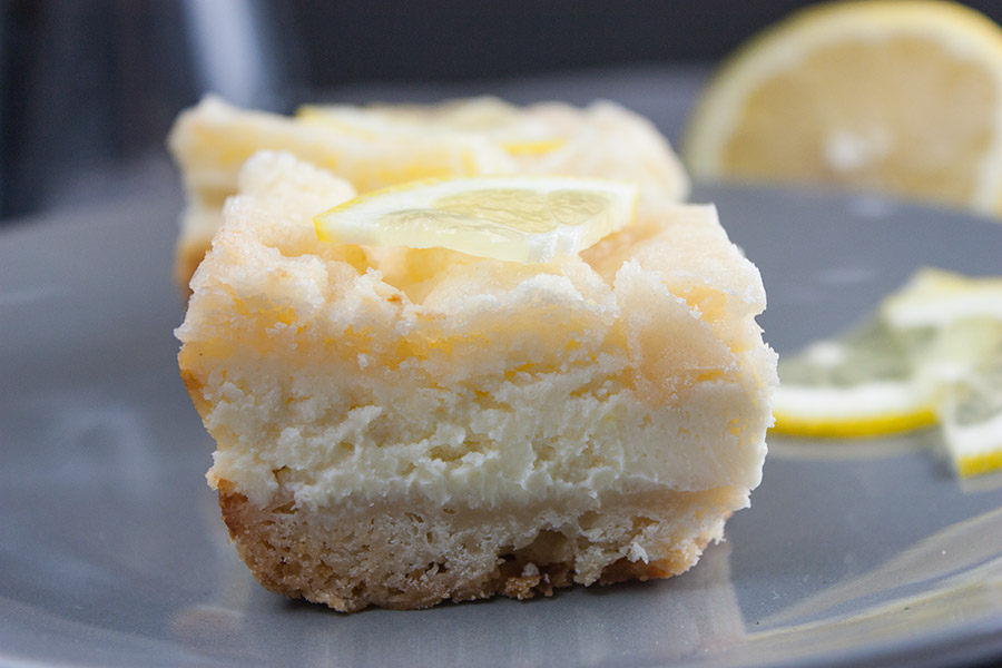 Lemon Cheesecake Shortbread Bars - These bars are delightfully tangy, sweet, cool, creamy, and oh so divine! A lemon lover's dream treat.
