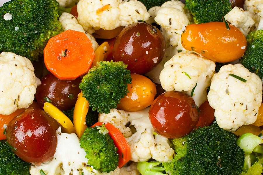 close up of fresh vegetables mixed with the marinade