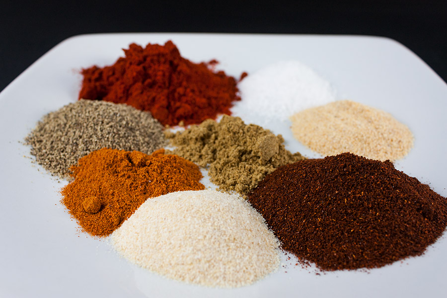rub spices separated on white plate