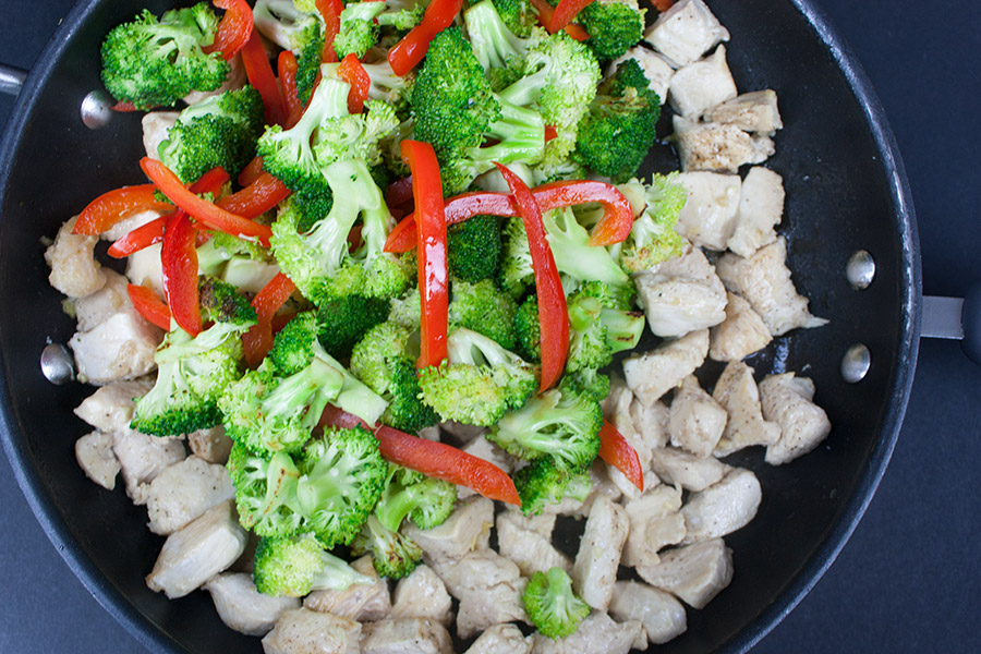 broccoli red bell pepper and chicken in skillet