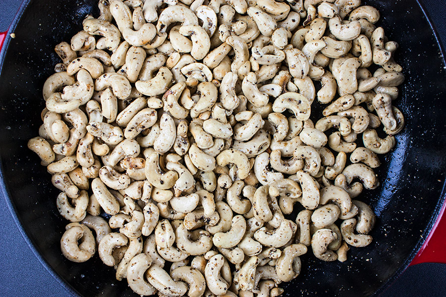 Salt and Pepper Roasted Cashews in red cast iron skillet