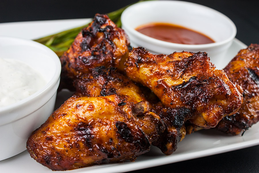 Cajun Smoked Wings - These barbecued wings have a spicy Cajun rub meeting up with some sweet Pecan wood smoke, then finished off with an aromatic hot sauce. They are deliciously smokey and spicy with a slight sticky sweet sauce that brings it all together in the most incredible wing you will ever have.