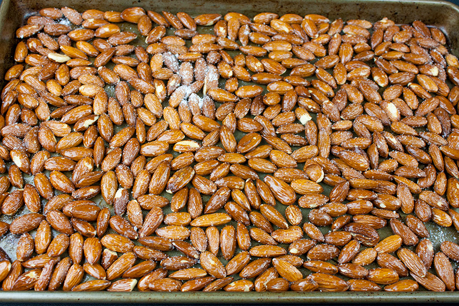 butter salted raw almonds on sheet pan