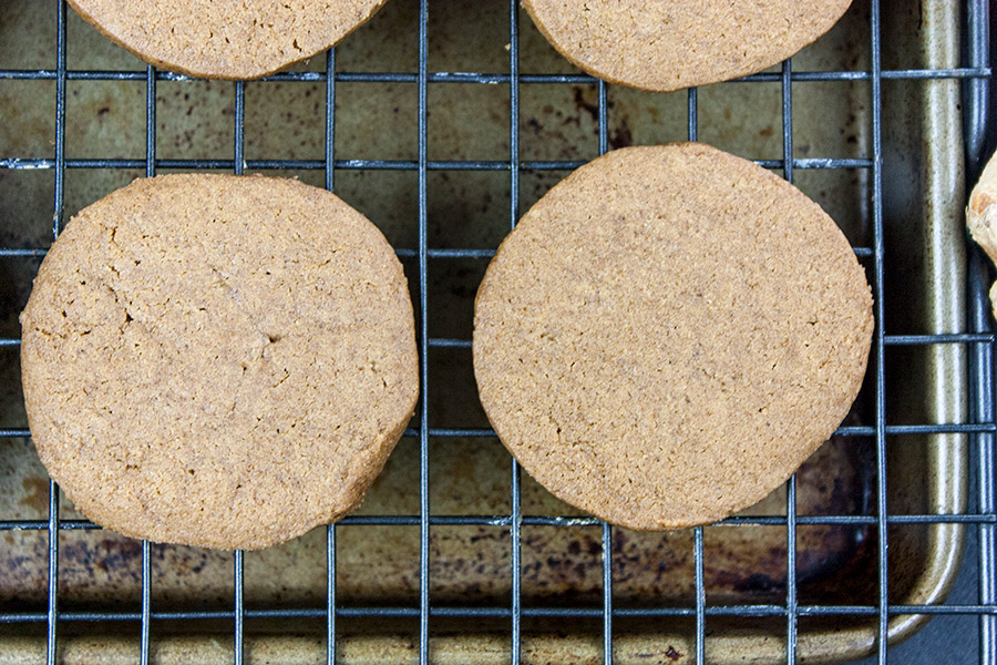 gingersnap cookies on wire cooling rack