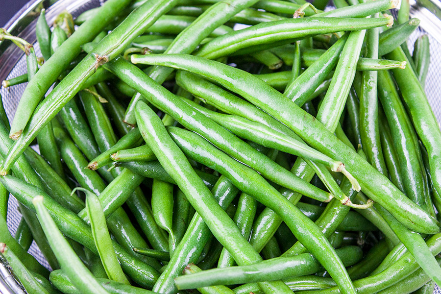 fresh washed green beans in a strainer
