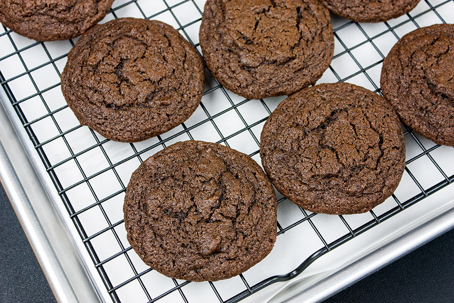 baked chocolate cookies on wire cooling rack