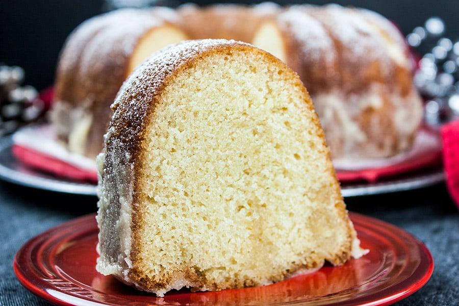 slice of eggnog bundt cake on red plate