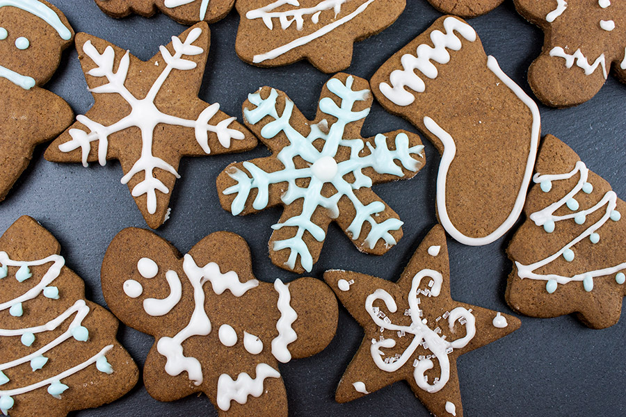decorated gingerbread cookies on a slate