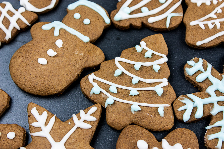 decorated gingerbread cookies on black slate