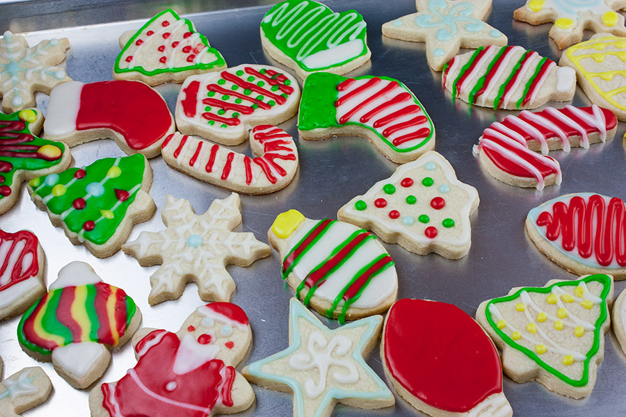 Decorated cut-out sugar cookies on a baking sheet