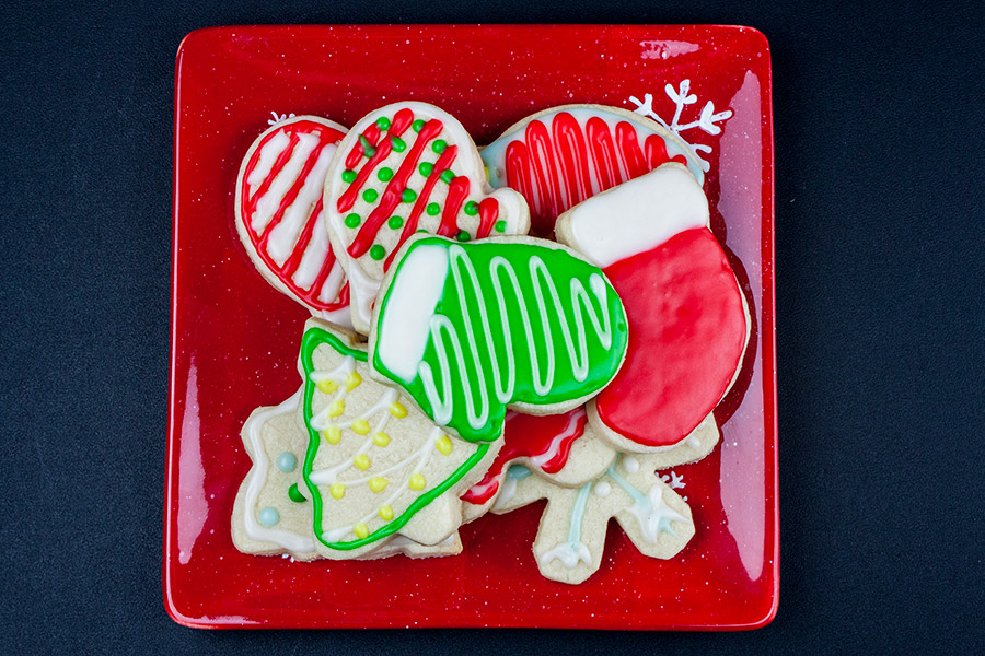 decorated cut-out sugar cookies on red plate