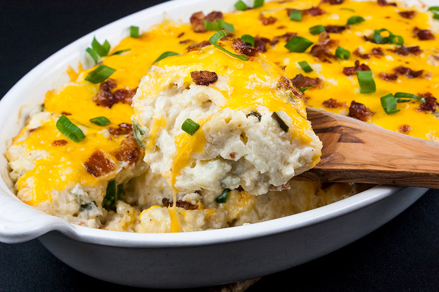 Loaded Cauliflower Mash Casserole - Perfect swap out for twice baked potatoes. It's unbelievably tasty and full of the loaded baked potato flavors you crave!