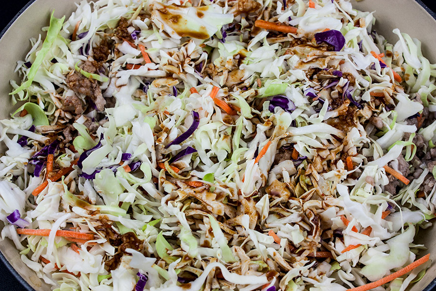 slaw mix placed in pan over the pork and drizzled with the sauce mixture