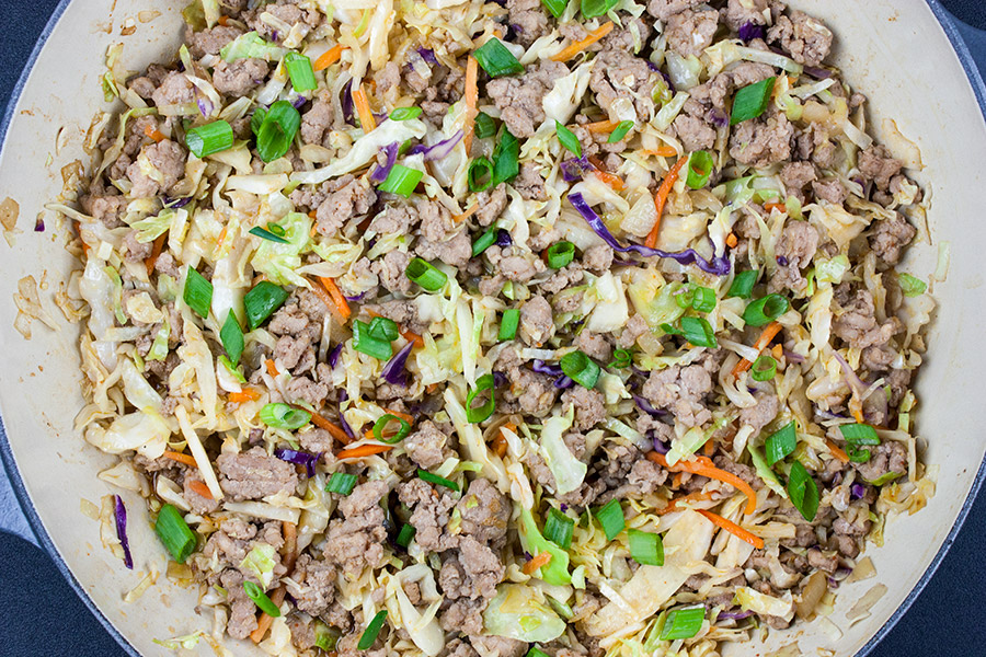 cooked pork egg roll bowl in the skillet