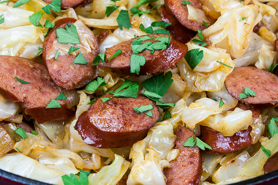 Fried Cabbage and Sausage -fried cabbage and sausage in red cast iron skillet
