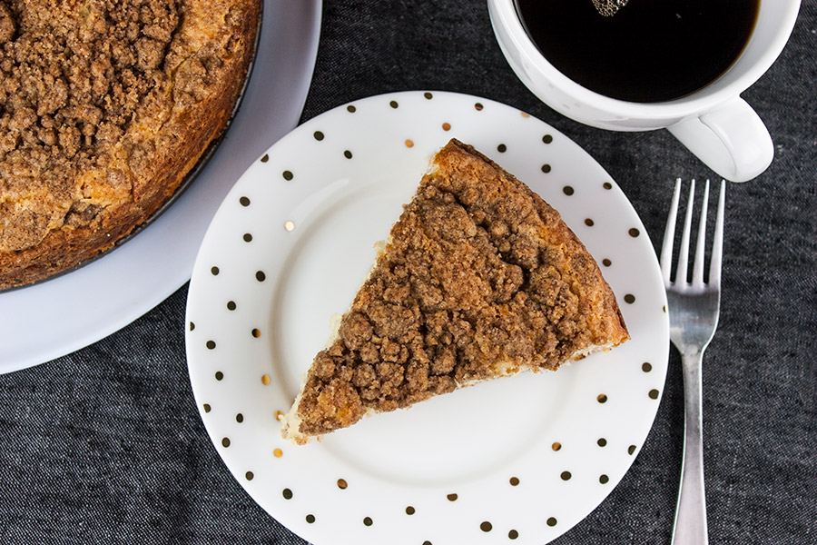 Cinnamon Crumb Coffee Cake - overhead shot of single slice on white plate