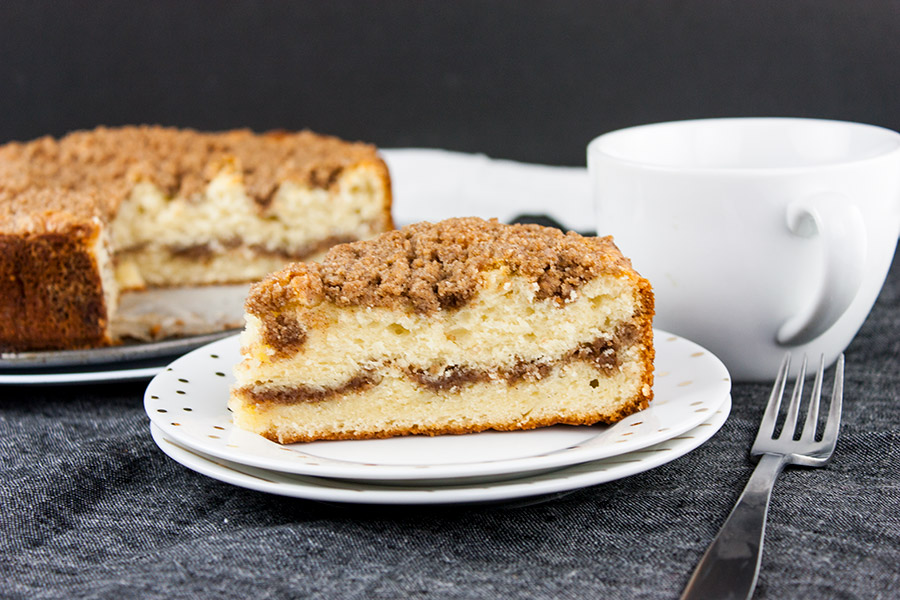 Cinnamon Crumb Coffee Cake - single slice on white plate