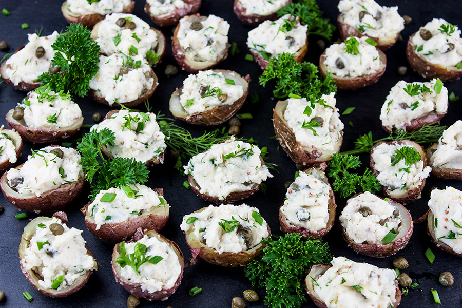 Deviled Potato Bites garnished with parsley on a piece of slate