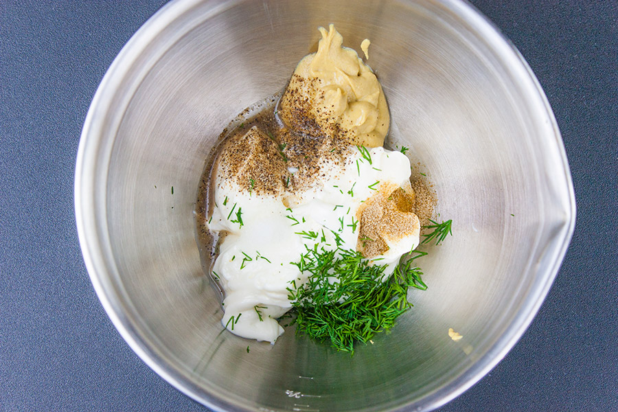 dressing ingredients in a small metal bowl for the Cauliflower Mock Potato Salad