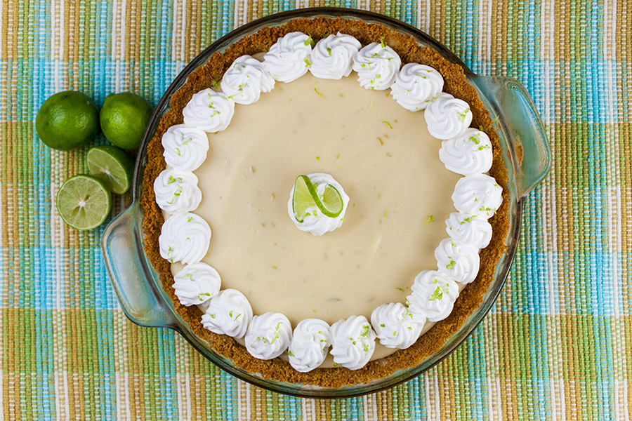 baked Easy Key Lime Pie garnished with whipped cream and lime zest