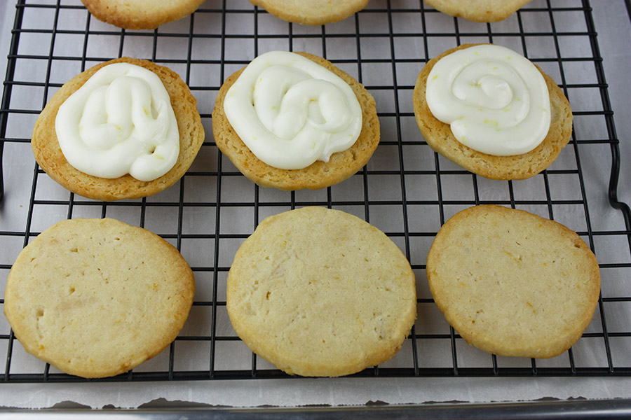 Lemon Sandwich Cookies - bottom half of cookies with filling piped on