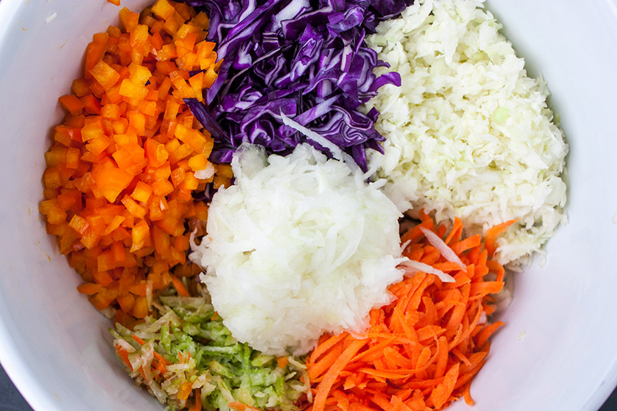 all the vegetables for the slaw in a large bowl